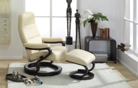 himolla Kennet Recliner shown in cream leather finish, in living room setting, with footstool in place.