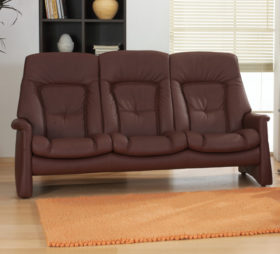 himolla Tanat Sofa, shown as 3-seat option, in brown leather, in living room setting.