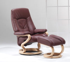 himolla Tanat Recliner, shown in dark brown leather, with footstool, in a studio setting.