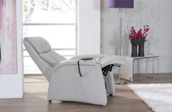 himolla Humber Lift and Rise Recliner, shown in pale grey leather, in reclined position, in a living room setting.