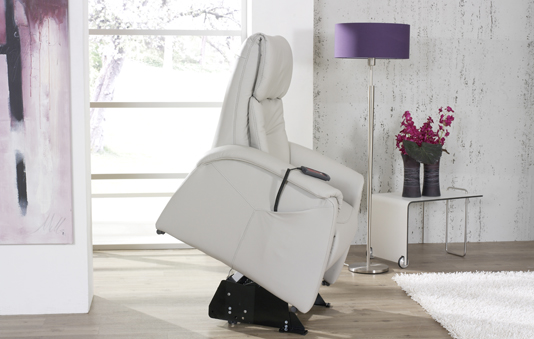 himolla Humber Lift and Rise Recliner, shown in pale grey leather, in a living room setting.