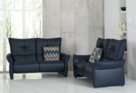 himolla Brennand Sofa, shown in dark blue leather in a living room setting.