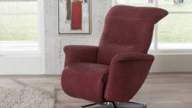 himolla Cygnet Recliner in deep red leather, shown in living room setting.