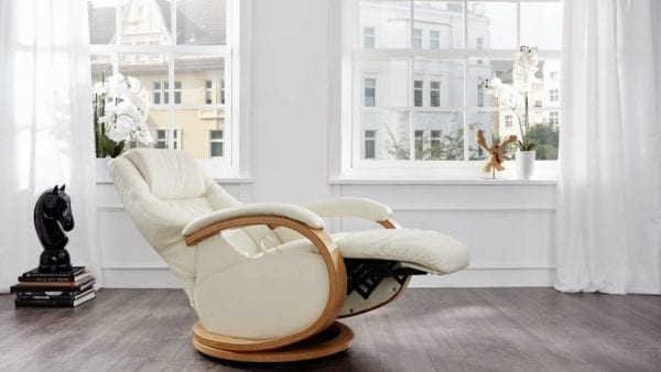 himolla Mersey Recliner, shown in cream leather, in open position, in a living room setting.