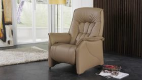 himolla Rhine Riser Chair in light brown leather, shown in living room setting.