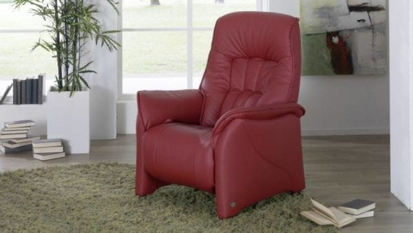himolla Rhine Riser chair, in red leather finish, shown in living room setting.