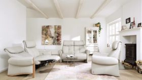 himolla Universe Sofas shown in pale grey leather, in a living room setting.